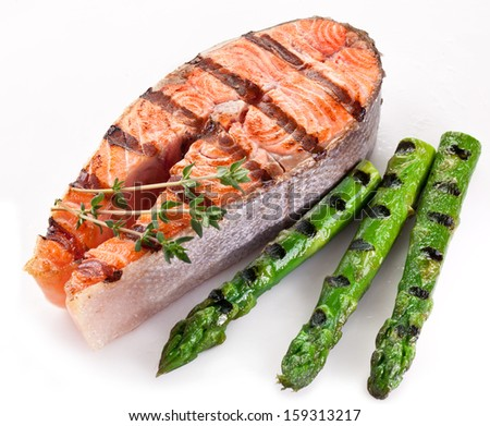 Grilled salmon and asparagus on a white background. - stock photo