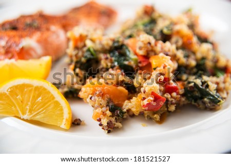 Grilled Salmon and Quinoa Pilaf with Kale and Peppers - stock photo