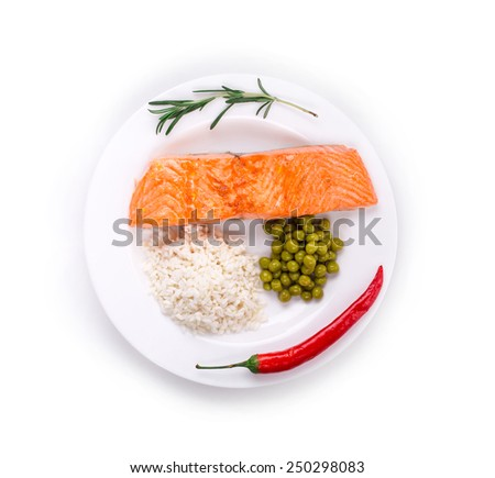 Grilled salmon fillet with risotto and peas on a plate. Isolated white background. - stock photo