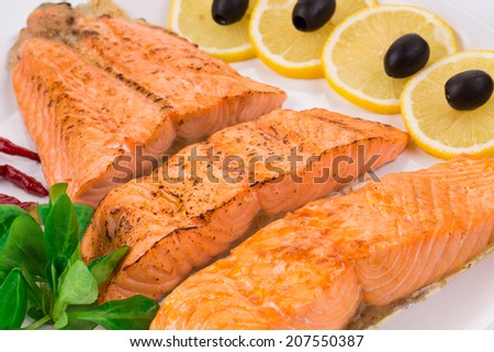 Grilled salmon fillets with rosemary. Whole background. - stock photo