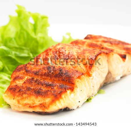 grilled salmon on white plate - stock photo