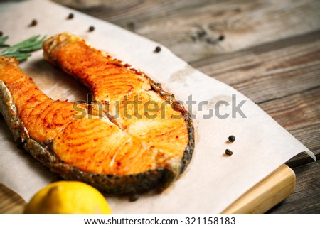 Grilled salmon on wooden table, top view with copyspace - stock photo