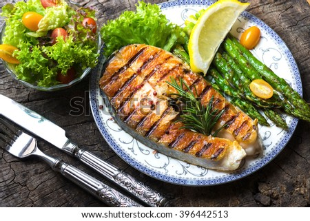 Grilled Salmon steak  with asparagus - stock photo