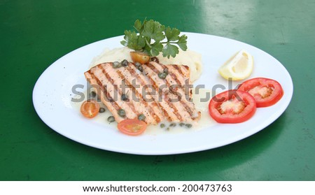 Grilled Salmon Steak with mashed potatoes - stock photo