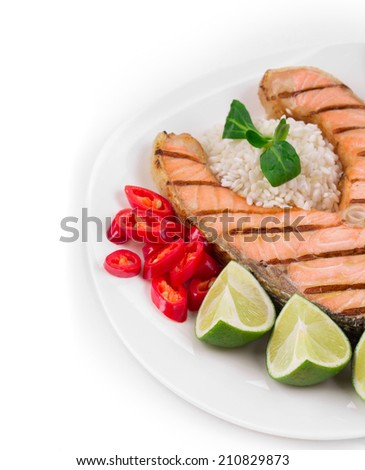 Grilled salmon steak with rice and vegetables. Isolated on a white background. - stock photo