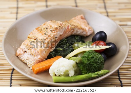 Grilled Salmon steak with the fresh vegetable  - stock photo