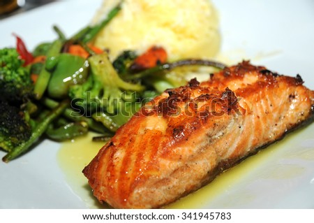 Grilled Salmon with cooked Vegetables and mashed potatoes on a white plate. Selective focus.   - stock photo