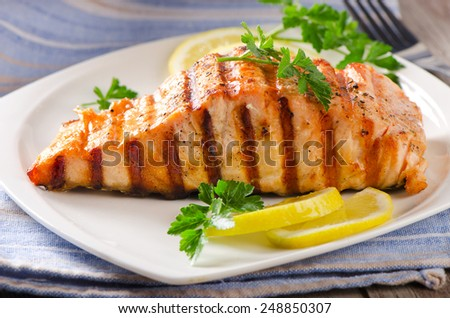 Grilled Salmon with lemon and  herb. Selective focus - stock photo
