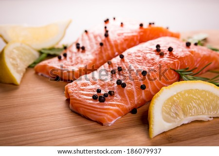 Grilled salmon with pepper and lemon - stock photo
