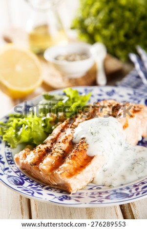 Grilled salmon with yogurt sauce - stock photo