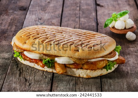 grilled sandwich with chicken and mozzarella cheese - stock photo