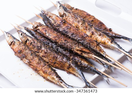 Grilled saury isolated on white background - stock photo