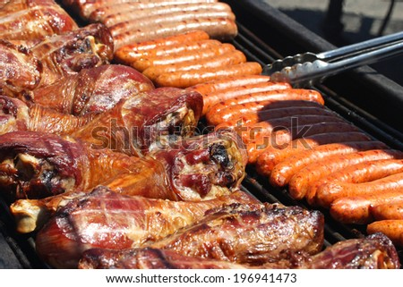 Grilled Sausages and Turkey Legs - stock photo