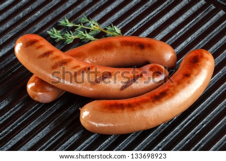 Grilled sausages on the barbecue - stock photo