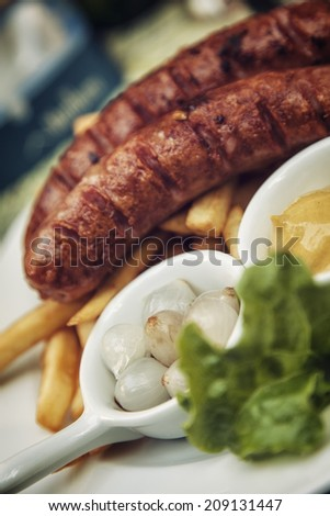 Grilled Sausages With Gravy And Salad - stock photo