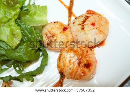 Grilled scallops with lettuce, indian style, closeup shot - stock photo