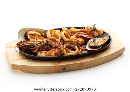Grilled Seafoods - BBQ Shrimps, Mussels and Calamari Rings - stock photo