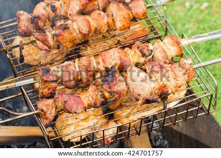 grilled shashlik skewers on street - stock photo