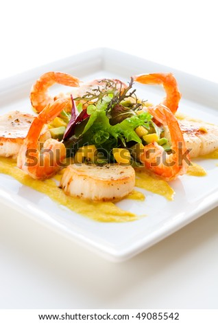 grilled shrimp and scallop salad with mango sauce - stock photo