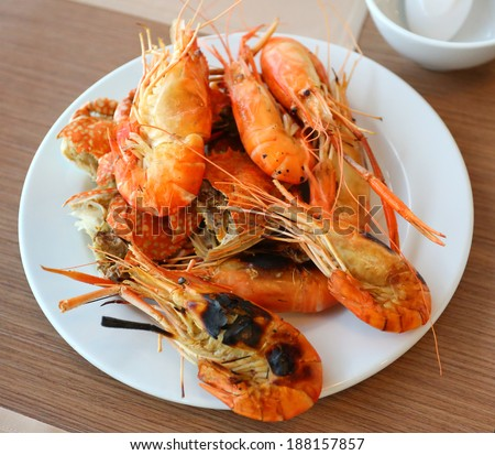 Grilled Shrimp on a plate at the table - stock photo