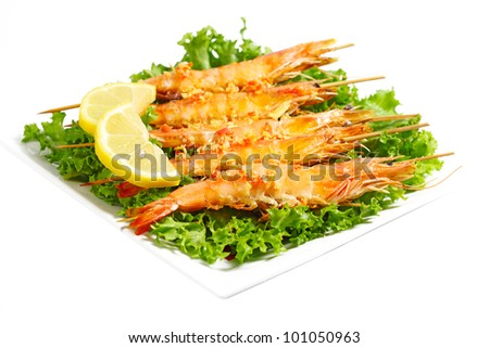 Grilled shrimps on chicory lettuce - stock photo