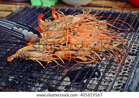 grilled shrimps on gridiron, shrimp barbecue - stock photo