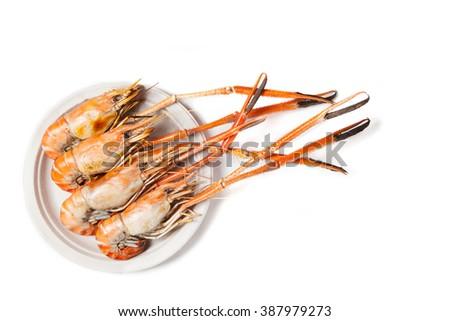 Grilled shrimps on whiite background with copy space - stock photo