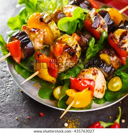 Grilled skewers of chicken and vegetables. Shallow DOF - stock photo
