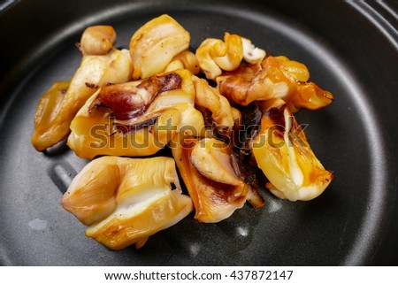 Grilled squid on frying pan   - stock photo