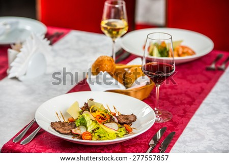 Grilled steak, grilled vegetables and bread on table, - stock photo
