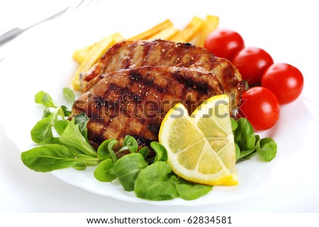 Grilled steak meat on a white plate on white isolated background - stock photo