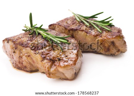 Grilled steak on white background - stock photo