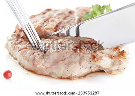 Grilled steak on white plate closeup - stock photo