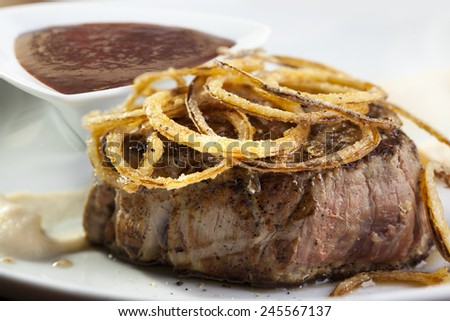 Grilled steak with caramelized onion rings  - stock photo