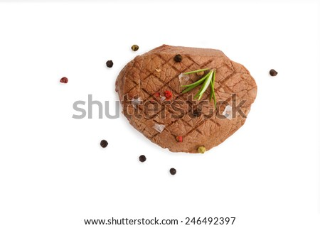 Grilled steak with fresh herb and colorful peppercorn isolated on white background, top view. - stock photo