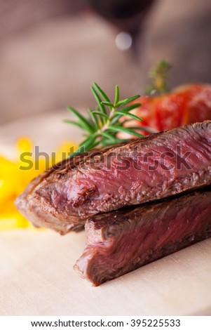 grilled steak with fries and tomato  - stock photo