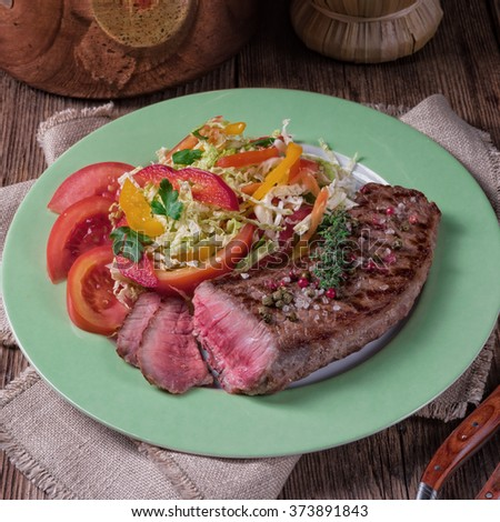 grilled steak with salad - stock photo