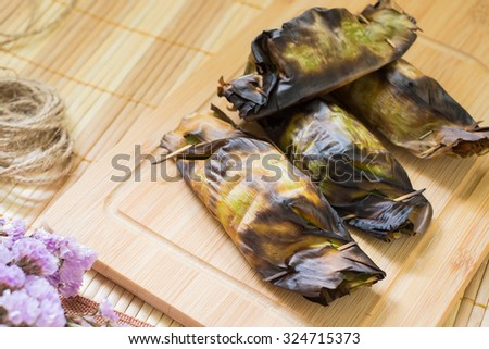 Grilled Sticky Rice with Taro and banana, thai cuisine - stock photo