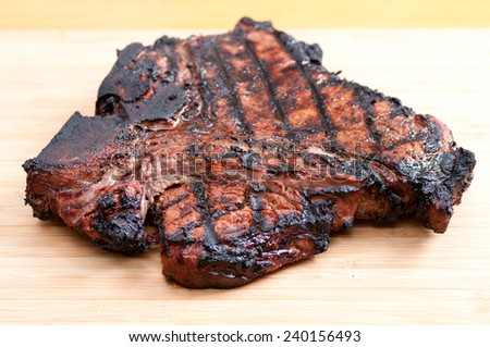 grilled t-bone steak with fresh vegetables - stock photo