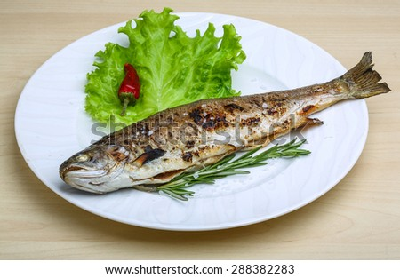 Grilled trout with rosemary and salad leaves - stock photo