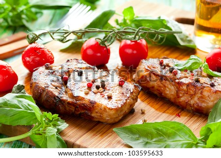 Grilled veal loin steak on cutting board - stock photo
