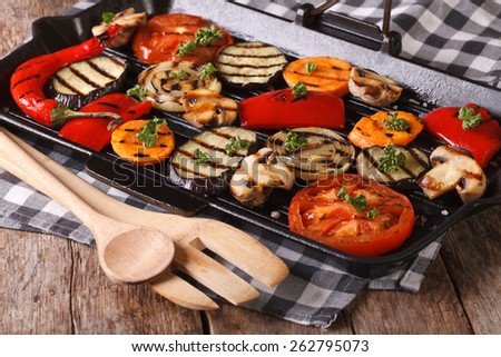 grilled vegetables: peppers, tomato, onion, eggplant, carrots and mushrooms in a pan grill. horizontal  - stock photo