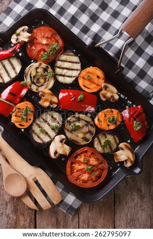 grilled vegetables: peppers, tomatoes, onions, eggplant and carrots in a pan grill. vertical view from above  - stock photo