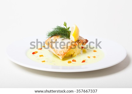 Grilled white-fish steak with mashed potato - stock photo