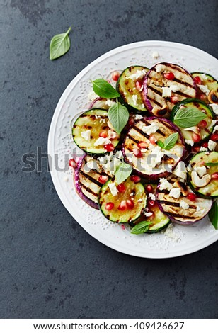 Grilled Zucchini and Aubergine with Feta, Pomegranate Seeds and Toasted Cashews  - stock photo