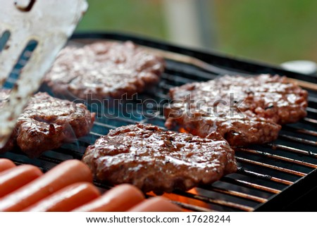 Grilling burgers and hot dogs - stock photo