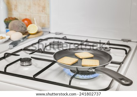 grilling pan toast burning flame gas stove - stock photo