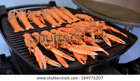 Grilling Scampi - stock photo