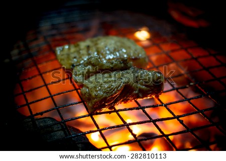 Grilling steak. - stock photo