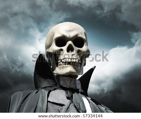 grim reaper. death's skeleton on a cloudy dramatic sky - stock photo